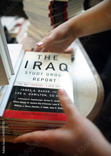 Patricia Klein Stacks Copies Of The Report From The Iraq Study Group  Patricia Klein Stacks Copies Of The Report From The Iraq Study Group At  Harvard Bookstore In