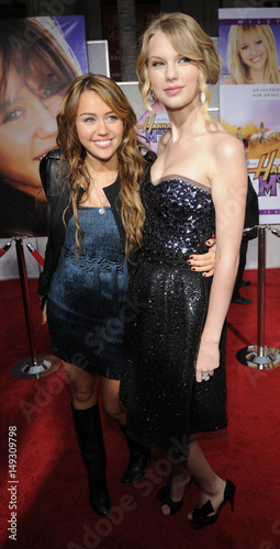 Cast Member Miley Cyrus And Singer Taylor Swift Attend The Premiere