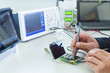 Person soldering in electronics laboratory