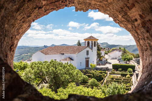 Church of portuguese town of Marvão seen through a hole Wallpaper Mural