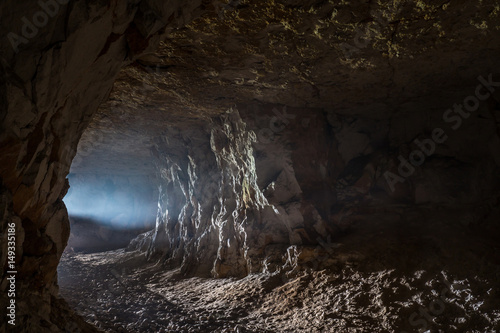 Fotografia A ray of light in the cave