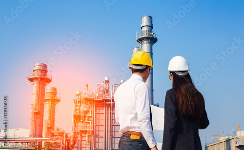 woman engineer and men engineer work new project in power plant