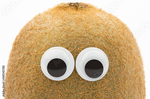 kiwi face with googly eyes on white background