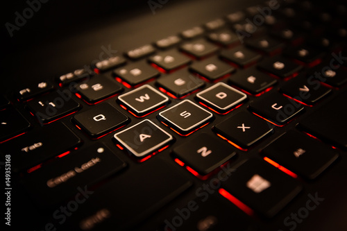 Photo  Black Laptop Computer Keyboard With Different WASD Buttons, and Illuminated Red