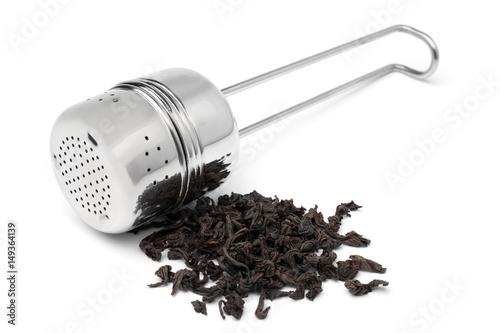 Valokuvatapetti Tea infuser cylinder with a handful of tea