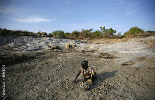 A Woman Collects Small Pieces Of Granite In Quarry The Remote Village Thumbalai