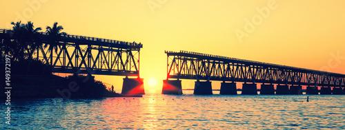 Tuinposter Zwavel geel Sunset with famous broken bridge