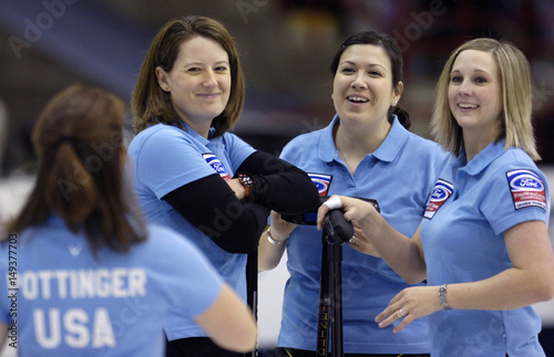 Team USA curlers smile during their game against Italy at the World
