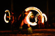 canvas print picture Fire dancers at Hawaii luau show, polynesian hula dance men jugging with fire torches.