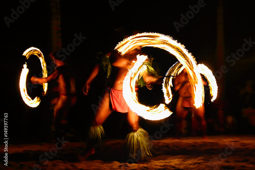 Obraz na plátně  Fire dancers at Hawaii luau show, polynesian hula dance men jugging with fire torches