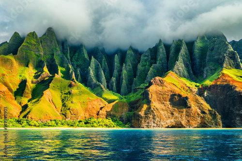 Cote Na Pali coast, Kauai, Hawaii view from sea sunset cruise tour. Nature coastline landscape in Kauai island, Hawaii, USA. Hawaii travel.