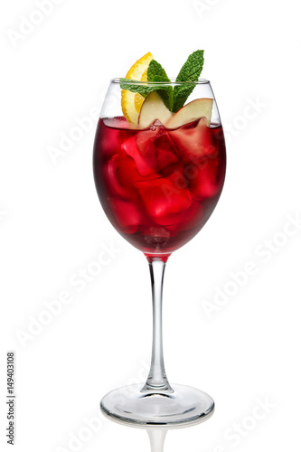 Cuadros en Lienzo Cold sangria in a wine glass isolated on white.