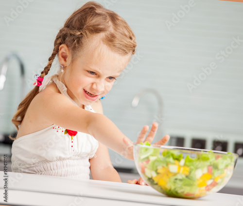 Little girl refuses to eat salad Canvas Print