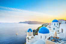 Classical View From Sunset Point At Oia Village White And Blue Architecture, Santorini Island, Greece. Incredible Evening Scenery.
