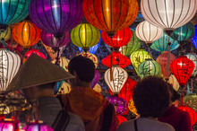 Tourists Explore The Old Street Of Hoi An Ancient Town With Colorful Lanterns, Quang Nam Province, Vietnam. UNESCO World Heritage Site