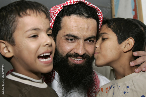 Jordans Osama Hassan Abu Kabir Hugs His Sons Usaid And Abdel Aziz At House In