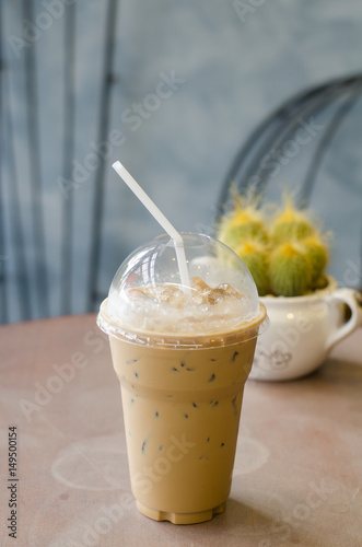 Foto op Aluminium Milkshake Iced coffee on wooden table background