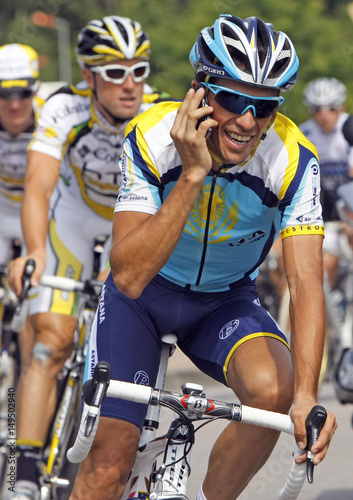 e2a5c710b Astana rider Alberto Contador of Spain uses a mobile phone as he cycles in  Limoges during the first rest day of the 96th Tour de France cycling race