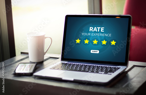 Obraz Businessman holding five star rating  Review increase rating or ranking, evaluation and classification concept - fototapety do salonu