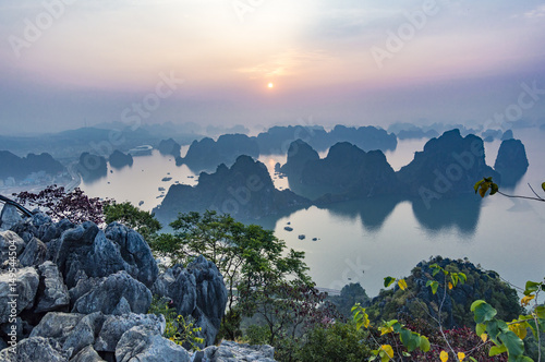 Karst landforms in the sea at the sunrise landscape view from Bai Tho Mountain in Halong Bay, Vietnam, Southeast Asia. UNESCO World Heritage Site