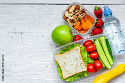 Printed kitchen splashbacks Assortment school lunch boxes with sandwich and fresh vegetables, bottle of water, nuts and fruits