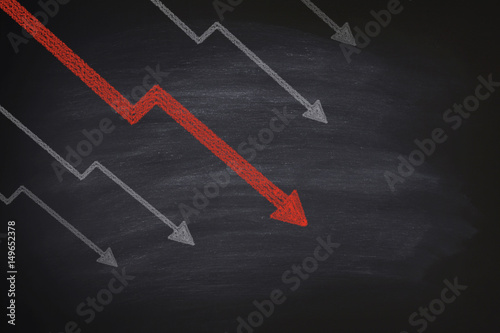 Decline in stocks on blackboard Canvas Print