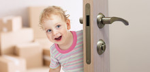 Happy Kid Behind Door In New R...