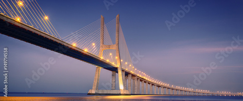 Fotobehang Brug sunrise on Vasco da Gama bridge