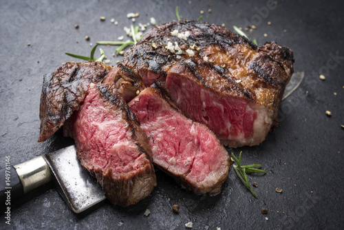 Foto op Canvas Steakhouse Barbecue aged Wagyu Rib Eye Steak as close-up on slate