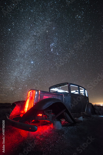 Photo  Rusty, Abandoned Car on Route 66 Under Winter Night Sky, Petrified Forest Nation