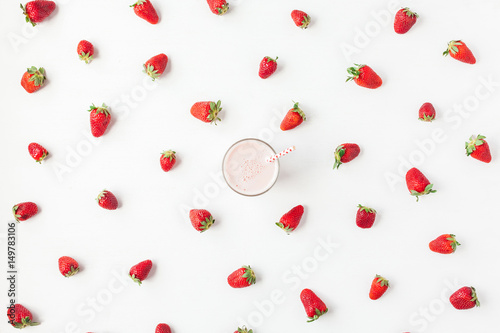 Foto op Aluminium Milkshake Strawberry milkshake, fresh strawberry on white background. Summer concept. Flat lay, top view