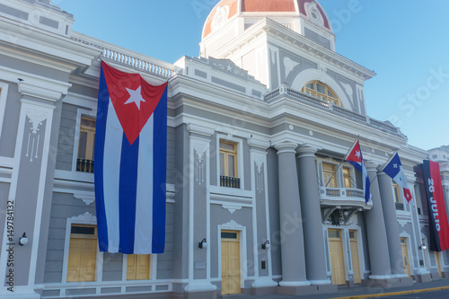 Fotografie, Obraz  Cuban flag in colonial facade, national day celebration