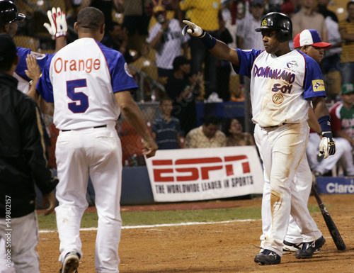 Tejada of the Dominican Republic celebrates after hitting a
