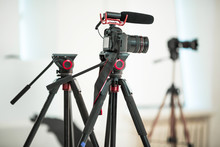 Concept Interview, Digital Camera On A Tripod With A Microphone In The Studio On A White Background.