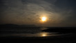 Beach sunrise and flock of birds, Lyme Regis, Dorset, England, UK