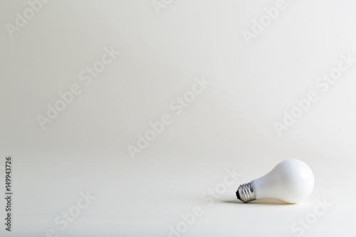 Photo  Colored lightbulb on a white background