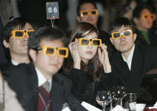 a71a9131df3 Participants wearing special glasses for 3D TV watch a 3D movie through LG  Electronics  3D TV during the company s 3D television strategy presentation  at LG ...