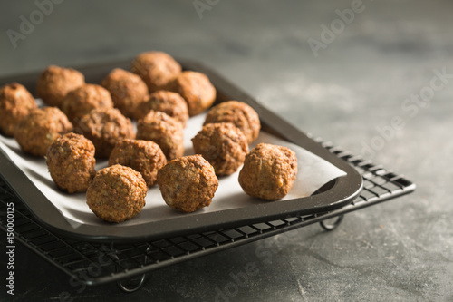 Homemade meatballs in oven tray