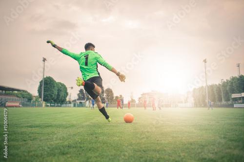 Fototapeta  Playing a football match