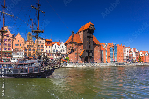 Pirate ship and historic port crane at Motlawa river in Gdansk, Poland