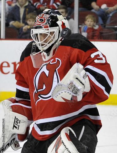 New Jersey Devils goalie Martin Brodeur makes a save against