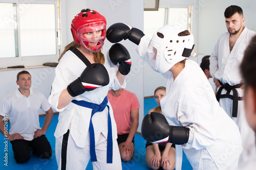 Fototapeta Women practicing at taekwondo class