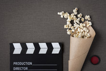 Clapperboard And Package With ...
