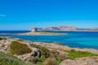 Beautiful turquoise blue mediterranean Pelosa beach near Stintino, Sardinia, Italy.