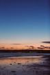 Sunset on beach with citylights