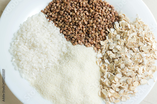 Rice, buckwheat, semolina and oat groats in glass jars  Useful and