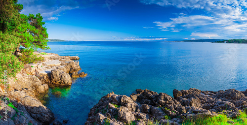 Poster Cote Wonderful romantic summer afternoon landscape panorama coastline sea. Green trees at the edge of the coast harbor at crystal clear azure water.