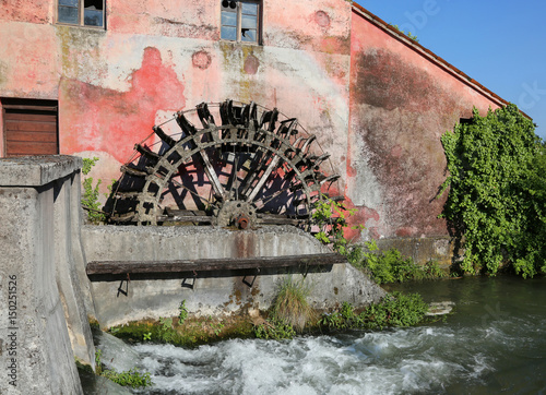 big wheel of an old abandoned water mill