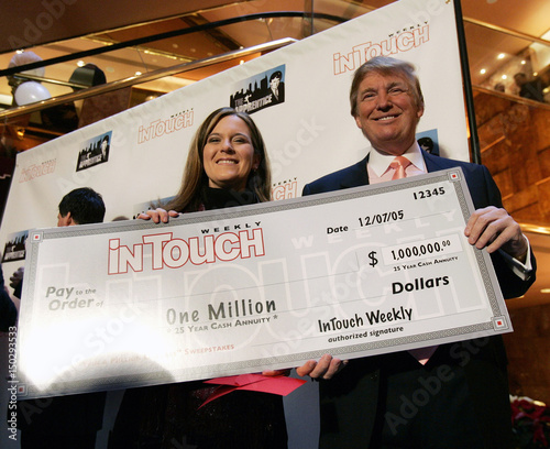 Trump poses with In Touch Weekly Million Dollar Sweepstakes winner