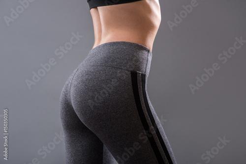 Fotografia Perfect female buttocks of fitness girl